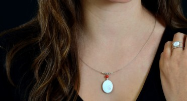 Silver Necklace with St Lucia Eye and Coral Pearl