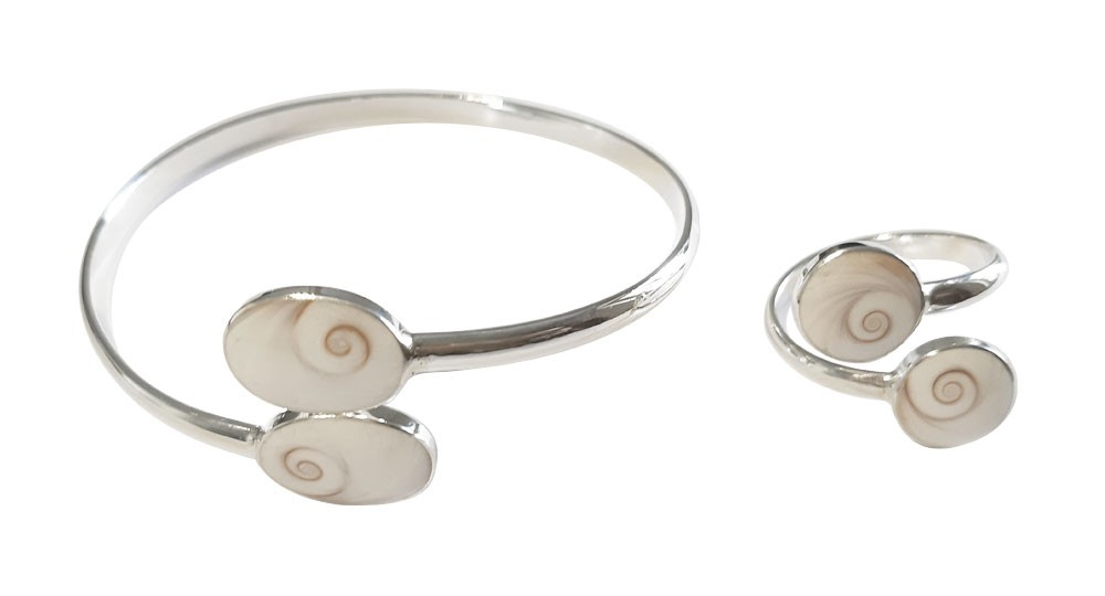 Silver jewelry set: adjustable bracelet and ring with 2 round Saint Lucia eyes